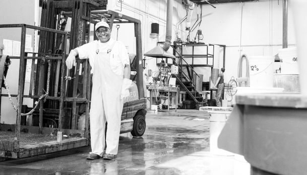 Smiling employee in manufacturing plant